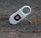 Öppnare med bl a korkskruv och ÖIS-logo